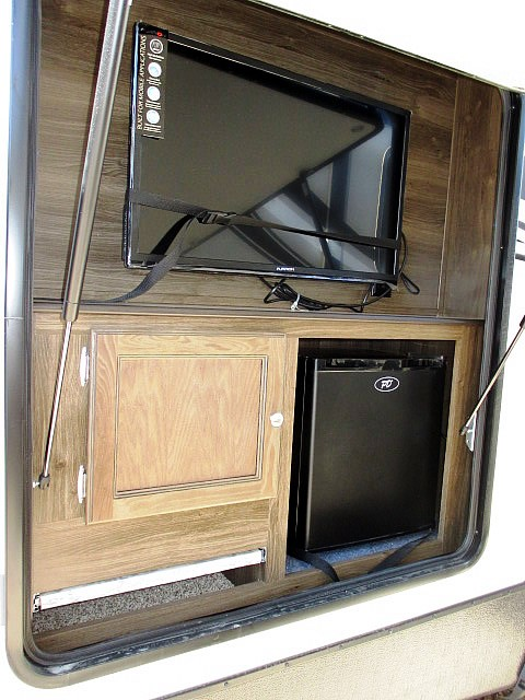 Grab a cold one and watch TV in our luxurious RVs