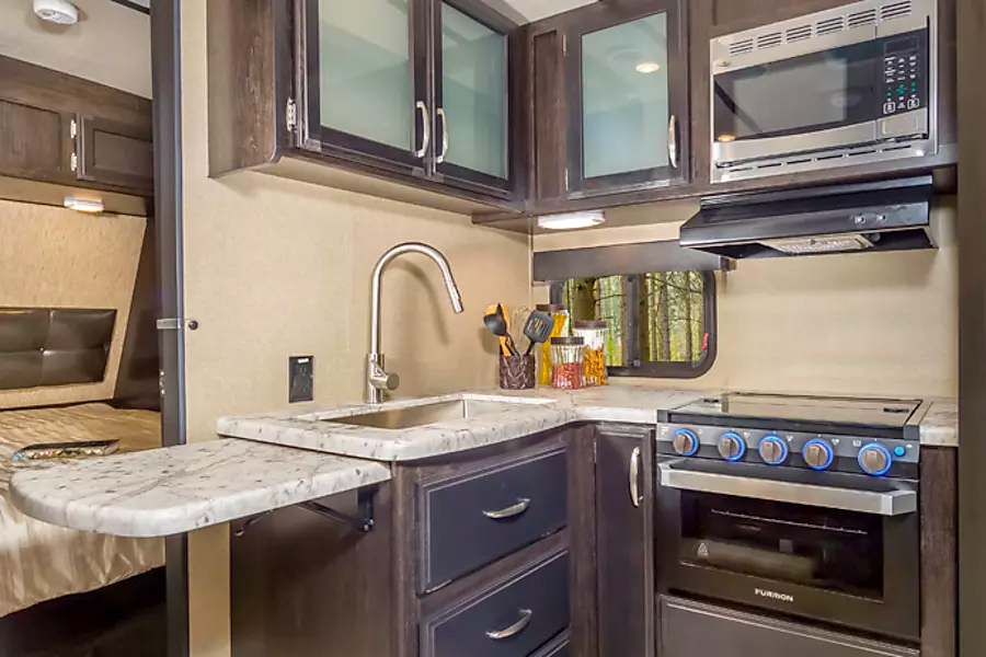 """Kitchen inside """"Texas Star"""", one of our premium travel trailers for rent."""
